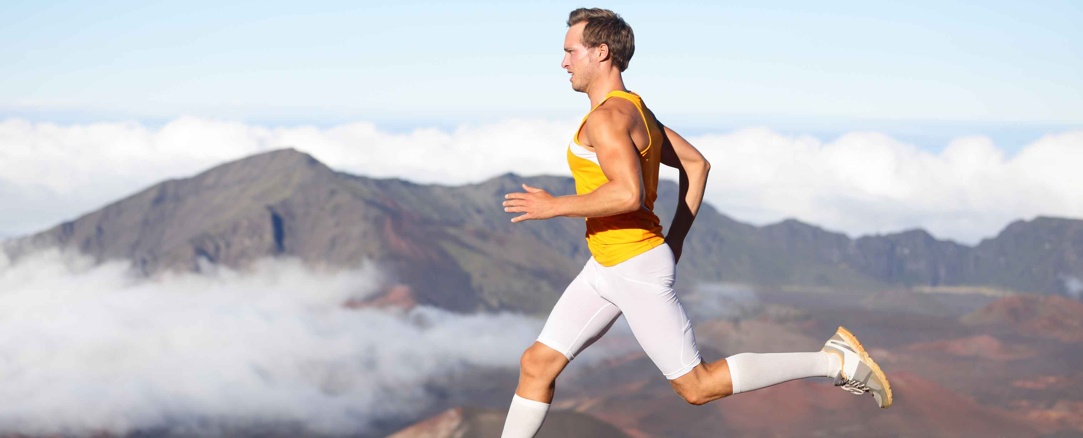 Runner man athlete running sprinting fast